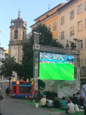 I love everything about this photo. Behind the big screen you can see the historic architecture and bouncy castles for kids. There was a crowd of about 200 watching the game between Argentina and Nigeria; quite a different scene from the Plaza and crowds in Lisboa!