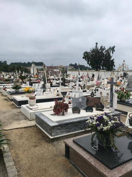 I've never seen anything like this cemetery. Every single grave had plaques, flowers, etc. piled on top. Quite lovely!