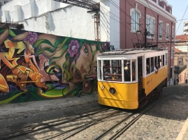 Urban Street Gallery. Home to the oldest operating streetcar/tram in Lisboa. Check out the hydraulics they have to use to keep it level due to the seriously steep grade of the stree!
