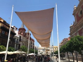 Plaza de San Francisco, right across from my apartment. Also, the Spanish still eat, drink, and play outside when it's 100°F, they just throw up giant tents to provide shade and some respite from the heat. It absolutely helps!