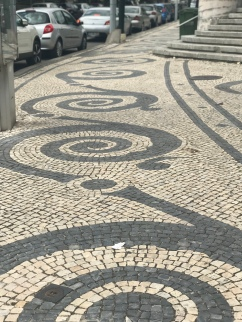 Gorgeous sidewalks across Portugal! (And of course, part of a staircase on the right captured in the photo.)