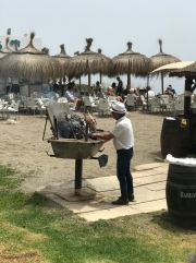All along the beach you can find these guys cooking sardines and other seafood in these boats over a wood fire ❤️