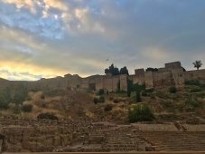 Early morning walk into historical part of the city center. View of the Roman Theatre and Alcazaba.