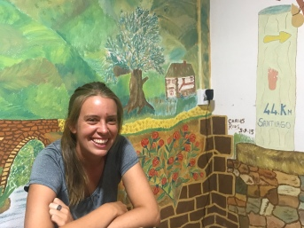 The lovely Julieta. Check out the adorable artwork on the wall of our alburgue- especially the mile-marker post!