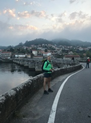 Jessy (and up ahead, Frederik) heading across the bridge and out of Arcade.