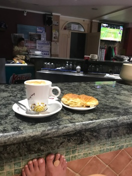 Coffee break of the day! My café, today's freee food was 1/2 of a croissant, and Wimbledon on in the background. And of course, shoes off and barefoot in the bar.