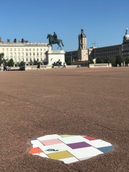 Don't understand why there is a single colored portion of tile work in Place Bellecour, but, here it is.