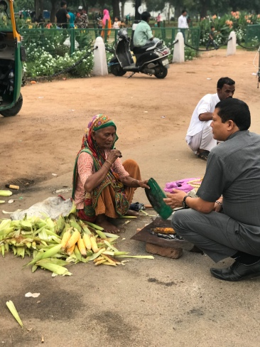 People all along the Rajpath selling corn.