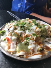 Chat Papdi. Drooling just thinking about this dish. But be careful where you order this from because lots of raw veggies on top that could make you sick.