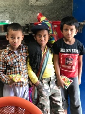 These three kids came into the home (which also has a small store) to buy some snacks. They loved posing for photos for John and me.