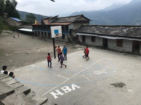 Watching boys playing basketball at Paudwar school.