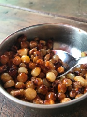 My fave treat in all of Nepal: mocai caija. Tried corn kernels that are roasted until they become plump and chewy, then a bit of oil and salt are added for flavor. YUM.