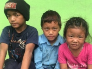 The boy on the left is sweet, but a special needs student in an area without any such resources. So, at 12yo, he's still in 1st grade. Santoush, in the middle, is in 3rd grade and was the smartest child at the school.