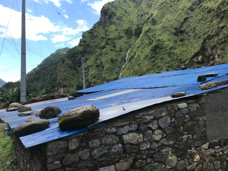 In Nepal, it's very common for people to use large stones to weigh down their roofs.