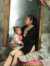 Laxmi baby-sitting her niece.