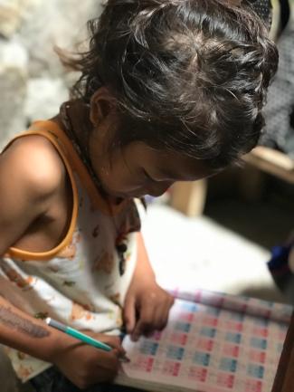 Anjali's son was hard at work (math homework).