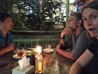 John & CP having quite the convo while we waiting for dinner at Umbrella Cafe (skip it).