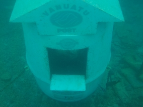 Underwater post office. Yes, it's real. And yes, you have to dive under water to deliver your post cards.