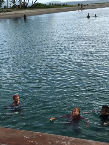 There are always adorable, local kids swimming near the jetty.
